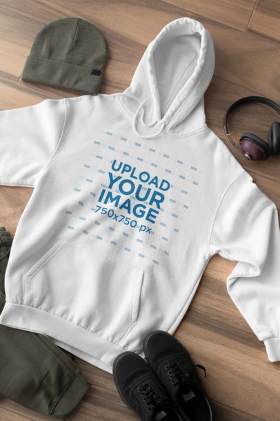 Hoodie Pullover Mockup Featuring a Men's Outfit Lying on a Wooden Surface 29817