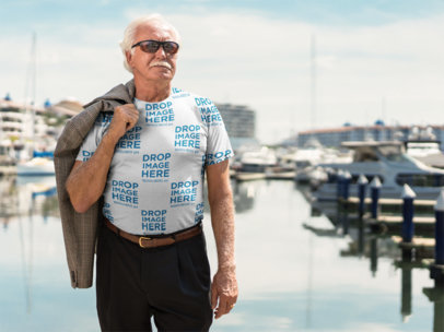 T-Shirt Mockup of a Man Standing on a Deck at the Marina a10932