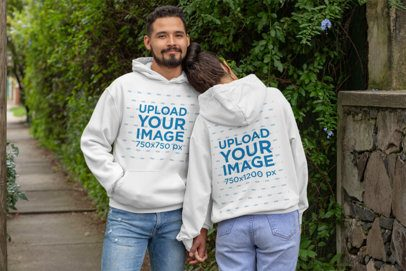 Front and Back Mockup of a Couple With Customizable Hoodies in the Street 29786