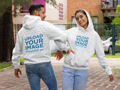 Front and Back Mockup of a Couple Wearing Pullover Hoodies 29787