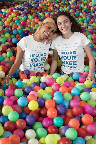T-Shirt Mockup of Two Best Friends Playing in a Ball Pit 29628