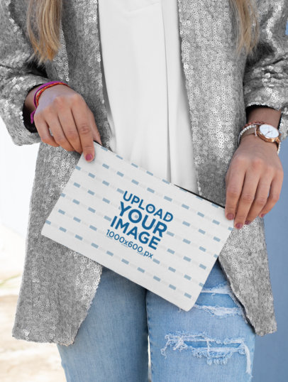 Mockup of a Stylish Woman Holding a Pouch 29968