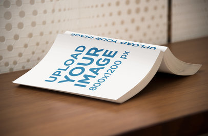 Mockup of an Open Digest Size Book Lying Facedown on a Desk 869-el