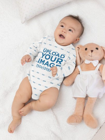 Mockup of a Baby Wearing a Sublimated Onesie in His Crib 30056