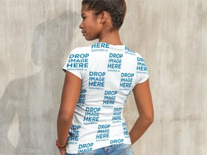 Back Shot of a Woman Wearing a Sublimated Tee Facing a Concrete Wall a9646b