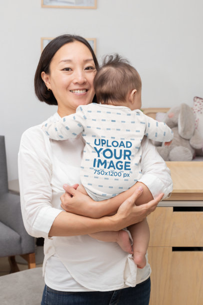 Mockup of a Mom Holding Her Baby Wearing a Onesie 30055
