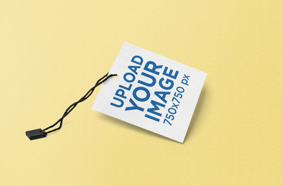 Mockup Featuring a Square Brand Tag Against a Solid Color Backdrop 858-el