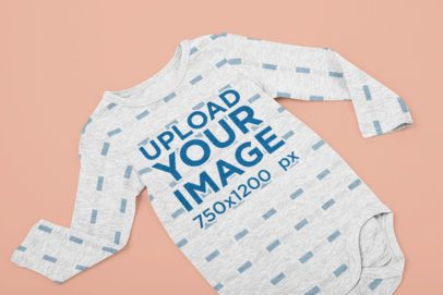 Mockup of a Heathered Long-Sleeve Onesie on a Flat Surface 29839