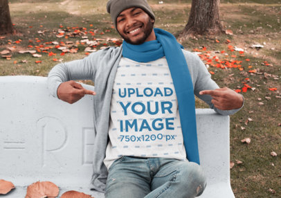 T-Shirt Mockup Featuring a Man Sitting on a Concrete Bench at a Park in Autumn 30284