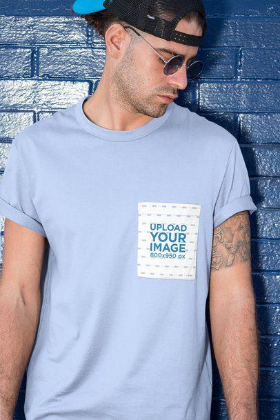 Pocket Mockup of a Man Posing Against a Brick Wall 30054