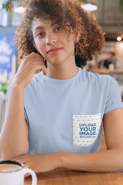 Pocket Mockup of a Woman Wearing a T-Shirt at a Cafe 30070