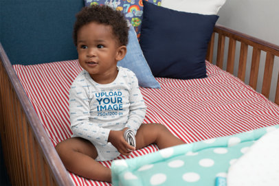 Mockup of a Baby Wearing a Heathered Onesie in His Crib 30026