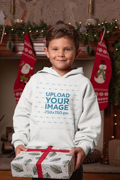 Mockup of a Boy with a Pullover Hoodie Holding a Gift in Christmas 30194