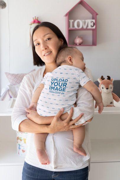 Mockup of a Sleepy Baby Wearing a Onesie 30039