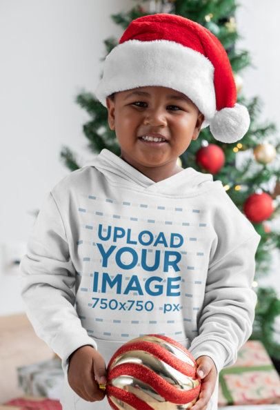 Hoodie Mockup of a Little Boy Playing with the Christmas Ornaments 30359