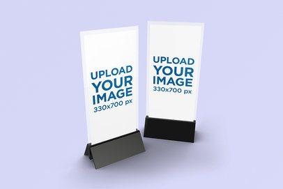 Mockup Featuring Two Table Tents Standing Against a Solid Color Backdrop 995-el