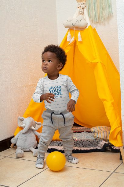 Onesie Mockup of a Boy Playing in a Tipi 30032