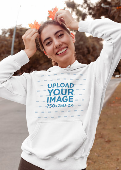 Hoodie Mockup of a Playful Woman in Fall 30116