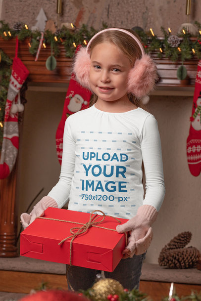 Mockup of a Girl Wearing a Long Sleeve Tee While Holding a Christmas Present 30195