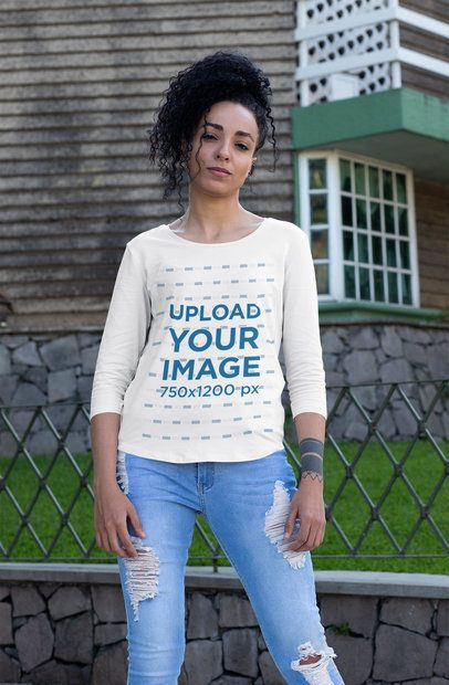 Three-Quarter Sleeve Tee Mockup Featuring a Fierce Woman Posing by the Street 30224
