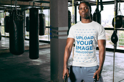 T-Shirt Mockup Featuring a Serious-Looking Man at a Boxing Gym 30157