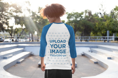 Back View Mockup of a Young Man Wearing a Three-Quarter Sleeve Raglan Tee 30209