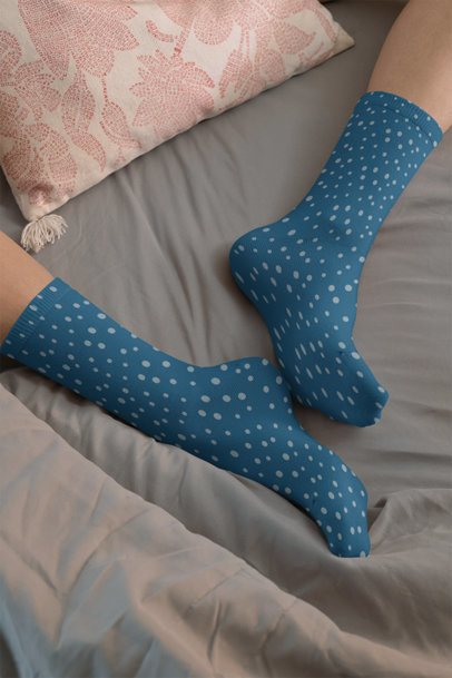 Mockup of a Woman on a Bed Wearing Sublimated Long Socks 29537