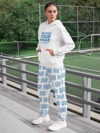 Sublimated Sweatpants Mockup of a Woman with a Hoodie by a Mini Soccer Field 29865