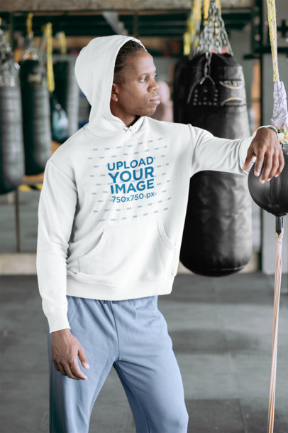 Mockup of a Man Wearing a Pullover Hoodie at a Boxing Gym 30165