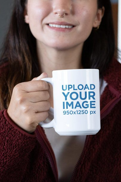 Mockup of a Woman with a Nose Piercing Holding a 15 oz Coffee Mug  30125