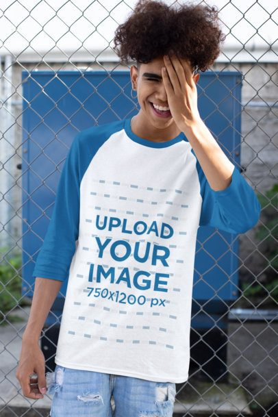 Mockup of a Young Man Wearing a Raglan Tee with Three-Quarter Sleeves Covering Half of His Face 30229