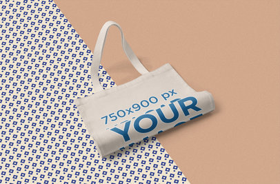 Cotton Tote Bag Mockup Placed over Different Fabrics 1060-el