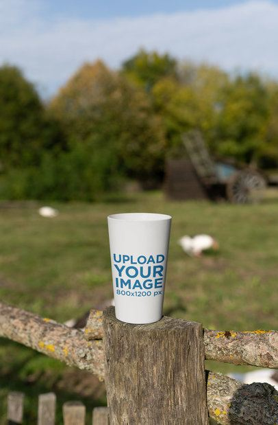 Mockup of a Reusable Cup Standing on a Lodge 30557