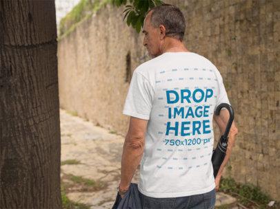 Back of an Elder Man Wearing a T-Shirt Mockup Carrying an Umbrella a10983b