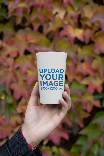 Mockup of a Reusable Cup with Autumn Leaves in the Background 30558