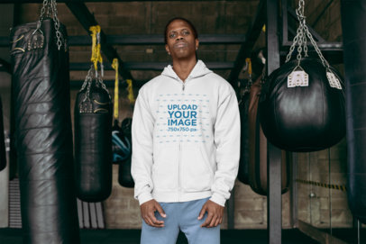 Full-Zip Hoodie Mockup of a Tough-Looking Man at a Boxing Gym 30168
