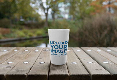 Mockup of a Reusable Cup on a Wooden Surface 30561