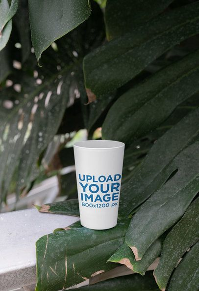 Mockup of a Reusable Cup Placed by a Plant 30564