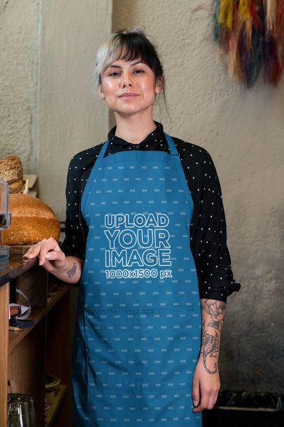 Mockup of a Tattooed Woman Wearing a Sublimated Apron 30270