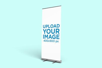Mockup Featuring a Roll-Up Banner Standing Against a Plain Background 915-el