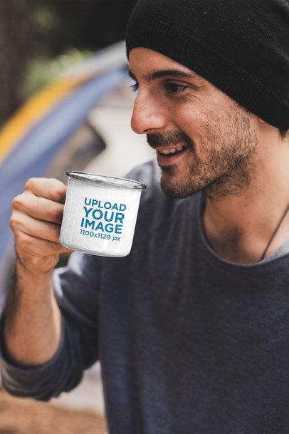Mockup of a Man Drinking from a 12 oz Silver Rim Enamel Mug at a Campsite 30478