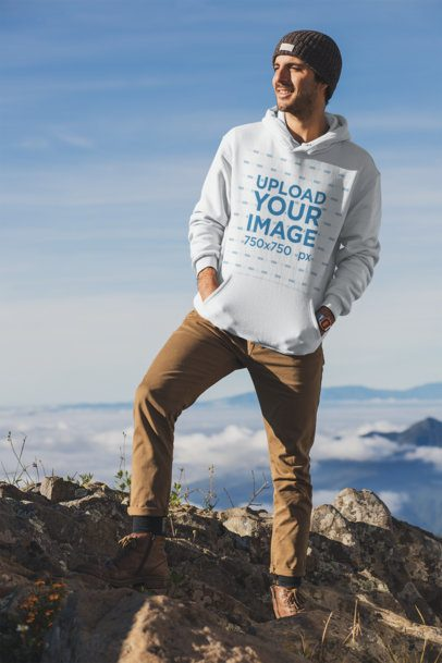 Pullover Hoodie Mockup Featuring a Man at the Top of a Mountain 30481