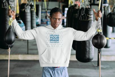 Mockup of a Man at a Boxing Gym Wearing a Pullover Hoodie 30166