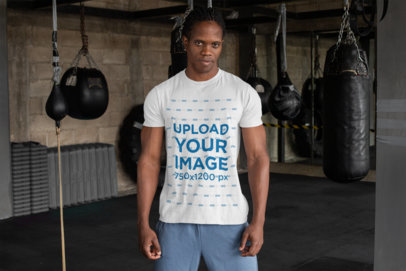 T-Shirt Mockup Featuring a Tough-Looking Man at a Boxing Gym 30171