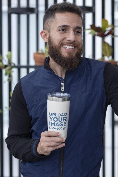 20 oz Travel Mug Mockup Featuring a Smiling Man by Some Wall Planters 30385