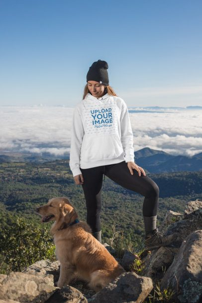 Mockup of a Female Hiker Standing at the Top of a Mountain with Her Dog 30496