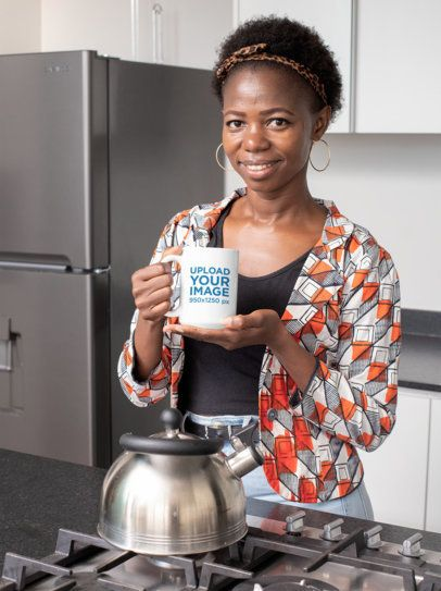 Mockup of a Woman in a Kitchen Holding a 15 oz Coffee Mug 30326