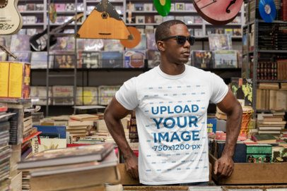 T-Shirt Mockup Featuring a Man with Sunglasses at a Vintage Records Store 30452