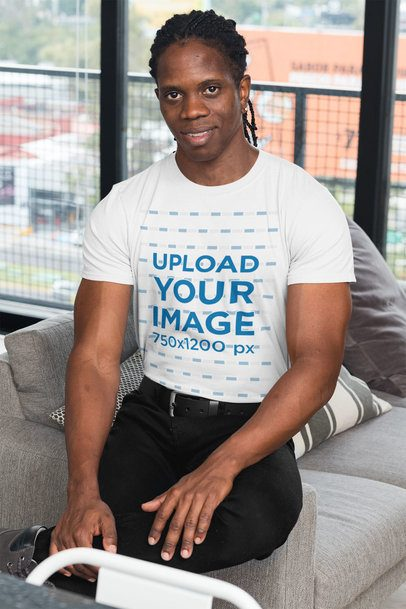 T-Shirt Mockup of a Muscular Man in a Living Room 30315