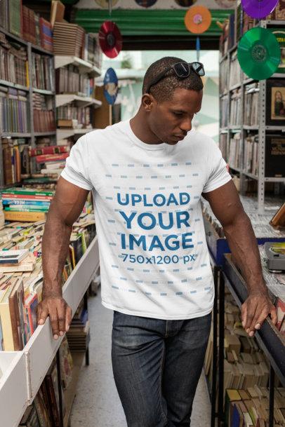 Crewneck T-Shirt Mockup of a Man at a Bookstore